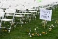 Rows of empty chairs, each one representing a seat on the downed MH17, arranged outside the Russian embassy in The Hague. Photo: Reuters