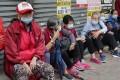 Elderly Hongkongers queue for free surgical masks in Sham Shui Po on February 14. Photo: Edmond So