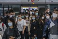 Commuters in masks at Admiralty station in Hong Kong. An expert says that while mainland China's situation is stabilising, the contagion has spread worldwide. Photo: Felix Wong