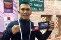 Eumir Felix Marcial poses with his 'Tokyo ticket' after qualifying for the Olympics. Photo: Philippine Athletes at Multi Sport Event