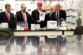 US President Donald Trump holds up a photo of the novel coronavirus during a tour of the US Centres for Disease Control and Prevention in Atlanta, Georgia, on Friday. Photo: Reuters