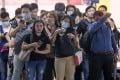 People wear masks as a precautionary measure against the spread of coronavirus in Manila on Tuesday. Photo: AP