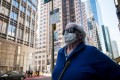 A pedestrian wearing a protective mask on the streets of San Francisco. Photo: Bloomberg
