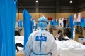 China reported just 19 new coronavirus cases on Tuesday. Photo: Xinhua