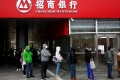 Chinese banks extended 905.7 billion yuan (US$130 billion) in new yuan loans in February, down from a record 3.34 trillion yuan (US$480 billion) in January and missing analyst expectations, according to data released by the People's Bank of China (PBOC) on Wednesday. Photo: Reuters