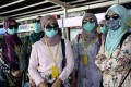 Passengers wearing face masks prepare to board fast boats bound for the Indonesian island of Nusa Penida. Photo: AFP