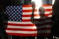 Protesters hold up a US flag at an anti-government rally in Hong Kong on December 1 last year. Photo: AP