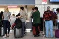 Travellers at Paris-Charles de Gaulle airport. Photo: AFP