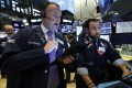 Traders on the New York Stock Exchange on March 10, as stocks try to recover from the massive oil shock plunge the day before. Photo: AP