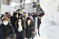 Visitors seen in masks at the annual Sapporo Snow Festival in Hokkaido, on February 4, 2020. Photo: Kyodo