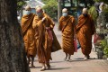 Thai Buddhist monks wear face masks to protect from the coronavirus in Bangkok on Tuesday. Photo: AP