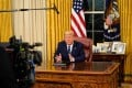 US President Donald Trump addresses the nation from the Oval Office of the White House on Wednesday night. Photo: Bloomberg