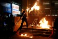 A protester throws a Molotov cocktail at an MTR station in Hung Hom on December 1. Photo: Reuters