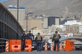 US customs officials patrol at an entry point in El Paso, Texas. A young woman died after falling while trying to climb the border wall near El Paso. Photo: AP