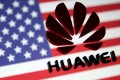 A 3D printed Huawei logo is placed on glass above a displayed US flag in this illustration taken January 29, 2019. Photo: Reuters