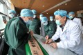 Members of a World Health Organisation coronavirus expert investigation group gather in Wuhan last month. Photo: DPA