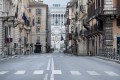 A deserted shopping street in Rome. Photo: AP