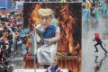 """A figure depicting US President Donald Trump as Emperor Nero """"fiddling while Rome burns"""" is displayed in a traditional carnival parade in Mainz, Germany. Photo: AP"""