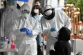 Medical workers take swabs to test for Covid-19 in Seoul. South Korea has mounted an extensive coronavirus testing regime. Photo: AFP