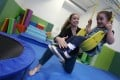 Jessica Tuohy (left), clinical director at therapy centre Spot, with four-year-old Kara Blaauw. Photo: Jonathan Wong