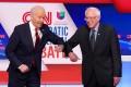 Democratic US presidential candidates Joe Biden and Senator Bernie Sanders do an elbow bump in place of a handshake. Photo: Reuters
