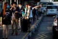 Commuters from Johor, Malaysia, head to Singapore on March 17, hours before Malaysia imposes a lockdown on travel due to the coronavirus outbreak. Photo: Reuters