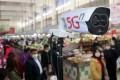 A new thermal temperature detector using 5G is pictured scanning customers at a market in Wuzhong district, Suzhou city, China's Jiangsu province, on Thursday Feb. 20, 2020. HANDOUT