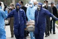 Men wearing protective gear carry the body of Fatemeh Rahbar, a lawmaker-elect from Tehran constituency, who died on Saturday after being infected with the new coronavirus. Photo: AP