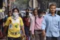 Pedestrians in Kolkata wear protective masks as a preventive measure amid the coronavirus outbreak. Photo: dpa