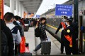 Migrant workers board special trains to return to their jobs in the cities as China tries to get back to normality. Photo: Xinhua