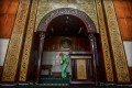 Medical officer sprays disinfectant in mosque amid the coronavirus outbreak in Tasikmalaya, Indonesia. Photo: Reuters