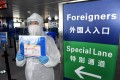 Travellers arriving from overseas are now subject to strict quarantine rules in Beijing and Hong Kong in a bid to prevent a second wave of the coronavirus pandemic. Photo: Xinhua