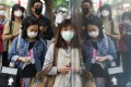 Face masks on all pedestrians in Tsim Sha Tsui, usually a bustling shopping and commercial district, as Hong Kong battles a novel coronavirus outbreak. Photo: Felix Wong