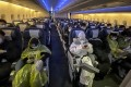 Passengers on a flight from London to Hong Kong are mostly decked out in protective gear. Photo: Emily Tsang
