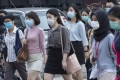 Workers walk to their offices while wearing face masks during a coronavirus lockdown day in Kuala Lumpur on Wednesday. Photo: EPA
