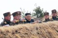 North Korean leader Kim Jong-un inspects an artillery fire competition between large combined units of the Korean People's Army (KPA) on March 20. The state fired two projectiles on Saturday morning. Photo: AFP