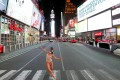 Ballerina Ashlee Montague wore a gas mask while dancing in the nearly deserted Times Square on Wednesday as the coronavirus outbreak continued to shut down New York City. US-China relations are fraying even further over accusations from each side that the other is responsible for the pandemic. Photo: Reuters
