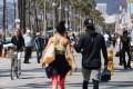 People walk along the Venice Beach boardwalk in Venice, California. Photo: AFP