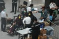 Travellers arriving at Hong Kong International Airport are questioned by Department of Health staff. Photo: Sam Tsang
