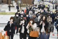 People visit to see the flame for this year's Tokyo Olympics exhibited in Ofunato, Iwate prefecture, on Monday. Japan is under increasing pressuring to postpone the Olympic Games because of the Covid-19 pandemic. Photo: Kyodo