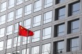 A Chinese flag flies outside the China Securities Regulatory Commission office in Beijing. A top official at the regulator has said that the effect of the global sell-off on mainland stocks would be temporary. Photo: Simon Song