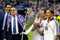 Lorenzo Sanz, the Real Madrid President holds the UEFA Champions League trophy with his nephew Michel Salgado. Sanz died of coronavirus in Spain. Photo: Reuters