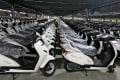 New scooters are lined up in a yard at an assembly line in a Honda manufacturing plant in Vithalapur, in the western Indian state of Gujarat, in June 2016. Photo: Reuters