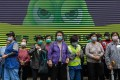 Street cleaners in Hong Kong wait in line to receive free face masks amid the coronavirus outbreak. Photo: EPA-EFE