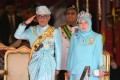 Queen Tunku Azizah with her husband, the king. Photo: AFP