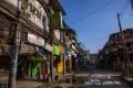 A man walks past closed stores near the Khari Baoli spice market in New Delhi on Sunday. Photo: Bloomberg