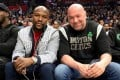 Retired boxing legend Floyd Mayweather with UFC president Dana White at an NBA game between the Los Angeles Clippers and the Boston Celtics last year. Photo: Instagram