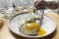 Avocado toast with sourdough bread and two fried eggs at Blackwood Cafe & Bar in Sheung Wan, Hong Kong. Photo: Holly Chik