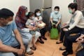 Chief Executive Carrie Lam Cheng Yuet-ngor visits ethnic minority families as part of a New Home Association activity to distribute face masks and other necessities, in Yau Tsim Mong district on March 1. Photo: ISD