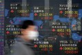 An electronic quotation board displays share prices of the Tokyo Stock Exchange and other world markets in Tokyo. Hedge-fund managers are under pressure to prove that they can provide uncorrelated performance during a market crash. Photo: AFP
